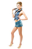 Atractive girl posing. In jeans outfit, isolated over white Stock Photos