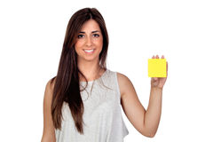 Atractive girl with a yellow post-it Royalty Free Stock Photos