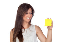 Atractive girl with a yellow post-it Royalty Free Stock Image