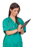 Atractive medical girl with a clipboard Stock Photography