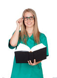 Atractive medical with glasses reading a book Royalty Free Stock Photo