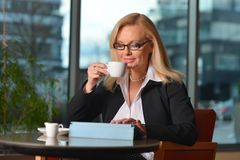 Atractive middle-aged blond businesswoman working Stock Photography