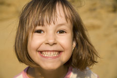Atractive smile of little girl. Cheer Royalty Free Stock Photography