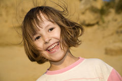 Atractive smile of little girl Stock Image