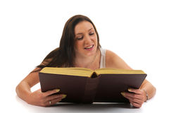 Atractive woman reading an book Stock Photography