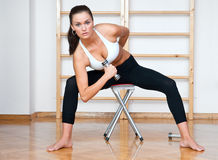 Atractive woman working out in gym Stock Image