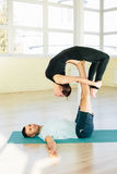 Atractive yoga couple Stock Photography