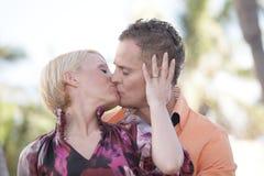 Atractive young couple kissing stock photos