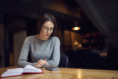 Atractive young girl trying understand bussines strategy of hostel and restraunt Stock Photos