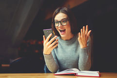 Atractive young girl trying understand bussines strategy of hostel and restraunt. Surprised young female blogger chatting with best friends in social network on Stock Image