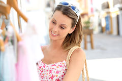 Atractive young woman shopping in the street. Attractive young woman doing shopping in tourist area Royalty Free Stock Image
