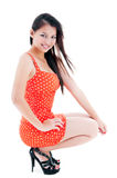 Atractive Young Woman Squatting Stock Photo