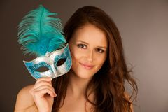 Atractive young woman with venice mask studio portrait Stock Photo