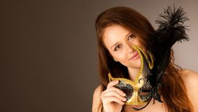 Atractive young woman with venice mask studio portrait.  Stock Images