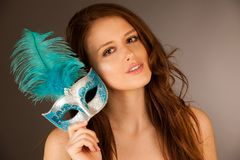 Atractive young woman with venice mask studio portrait.  Stock Image