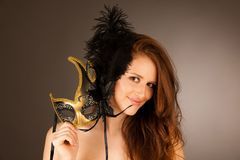 Atractive young woman with venice mask studio portrait.  Royalty Free Stock Images