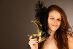 Atractive young woman with venice mask studio portrait Stock Photos