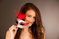 Atractive young woman with venice mask studio portrait.  Stock Photos