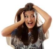 Atractivos adolescentes de la muchacha sorprendidos hacen las caras aisladas en blanco Fotografía de archivo