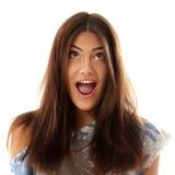Atractivos adolescentes de la muchacha sorprendidos hacen las caras aisladas en blanco Fotos de archivo