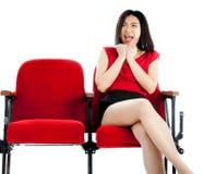 Atrakcyjna Azjatycka dziewczyna 20s przy theatre odizolowywa białego tło Zdjęcie Stock