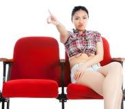 Atrakcyjna Azjatycka dziewczyna 20s przy theatre odizolowywa białego tło Zdjęcia Stock
