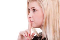 Atrakcyjna blondynki kobieta robi cisza gestowi zdjęcia royalty free