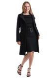Atrakcyjna blondynki kobieta w czarnym zima żakiecie, odosobnionym na bielu Zdjęcie Royalty Free