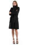 Atrakcyjna blondynki kobieta w czarnym zima żakiecie, odosobnionym na bielu Zdjęcie Stock