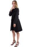 Atrakcyjna blondynki kobieta w czarnym zima żakiecie, odosobnionym na bielu Obrazy Stock