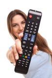Atrakcyjna caucasian kobieta z TV pilotem zdjęcie stock