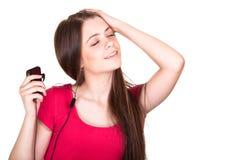 atrakcyjna dziewczyna słucha muzyki ja target1655_0_ nastoletni Zdjęcie Royalty Free