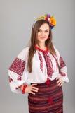 Atrakcyjna kobieta jest ubranym Ukraińską obywatel suknię fotografia stock