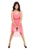 Atrakcyjna kobieta w menchii sukni z koltem Zdjęcia Stock