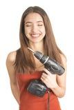 Atrakcyjna młoda kobieta trzyma cordless śrubokręt Fotografia Stock