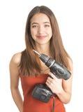 Atrakcyjna młoda kobieta trzyma cordless śrubokręt Zdjęcie Stock