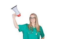 Atrakcyjna medyczna dziewczyna z megafonem obraz stock