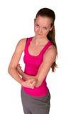 Atrakcyjna sprawności fizycznej kobieta pozuje w sportswear  Obrazy Stock