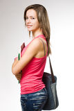 Atrakcyjna studencka dziewczyna jest ubranym cajgi. Obraz Stock