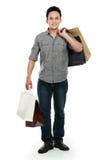 atrakcyjnej torby szczęśliwy męski zakupy Fotografia Stock