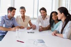 Atrakcyjni ludzie biznesu przy spotkaniem Fotografia Stock