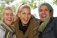 Atrakcyjni uśmiechnięci ludzie zbliżenie portret Zdjęcia Royalty Free