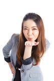 Atrakcyjny bizneswoman przedstawia coś na palmie ona Zdjęcie Stock