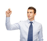 Atrakcyjny buisnessman lub nauczyciel z markierem Zdjęcia Stock