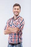 Atrakcyjny dysponowany facet wyraża pozytywne emocje Zdjęcie Stock