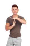 Atrakcyjny facet z spiky włosianym gestykuluje czasem Zdjęcie Royalty Free