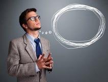 Atrakcyjny mężczyzna myśleć o mowy lub myśli bąblu z co obrazy royalty free
