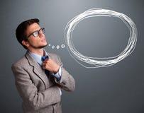 Atrakcyjny mężczyzna myśleć o mowy lub myśli bąblu z co obrazy stock