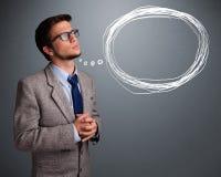 Atrakcyjny mężczyzna myśleć o mowy lub myśli bąblu z co fotografia stock