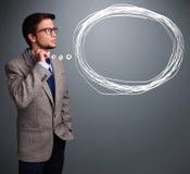 Atrakcyjny mężczyzna myśleć o mowy lub myśli bąblu z co zdjęcia royalty free